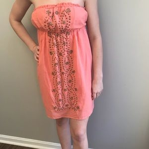Peachy Pink Strapless Dress With Gold Stud Front